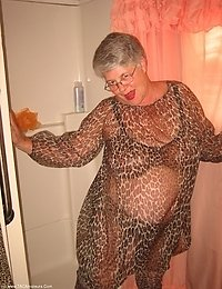 Big momma Girdlegoddess is sexy hot in leopard print sheer cover up Just getting ready for a nice shower Look at how nice and WET i am