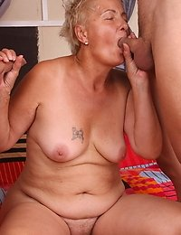 Horny granny fills her mouth and pussy with dick